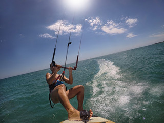 Man jumping with Kite surf . Action cam on board view