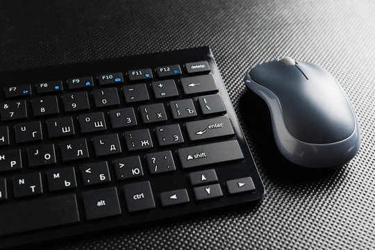 keyboard and mouse on the table .