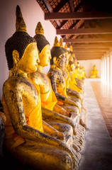 Image of Buddha in old temple of Thailand , light and flare effect