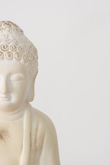 Buddha ornament on white background with copy space for text.