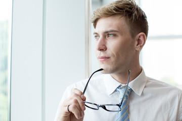 Pensive Business Man Looking Through Window