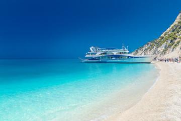 Wall Mural - Tourist ship on the Egremni beach, Lefkada, Greece.