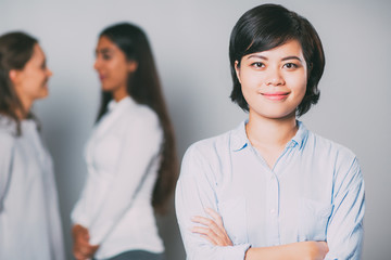 Portrait of happy young Asian businesswoman