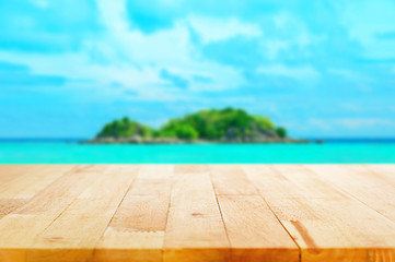 Wood table top on blur  island background