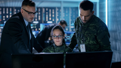 Government Surveillance Agency and Military Joint Operation. Male Agent, Female and Male Military Officers Working at System Control Center.