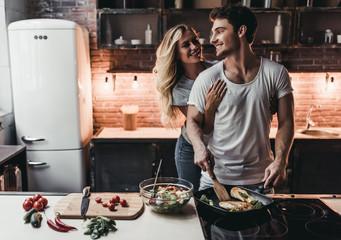 Couple on kitchen