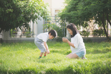 Asian children playing on green grass