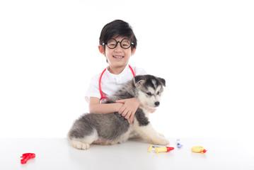 Asian child playing veterinarian