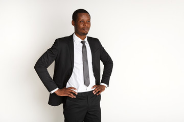 Handsome african business man posing isolated