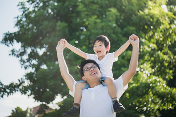 Father and son playing in the park