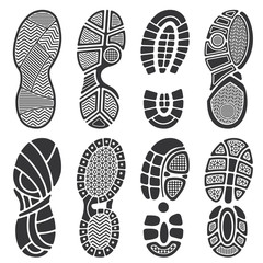 Isolated footprint vector silhouettes. Dirty shoes and sneakers footprints