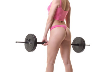 Cropped image of a young sexy woman with barbell