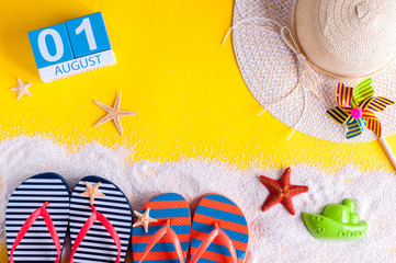 August 1st. Image of august 1 calendar with summer beach accessories and traveler outfit on background. Summer vacation concept