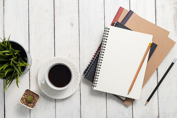 Empty notebook and coffee on  wooden table Wall mural