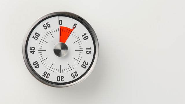 Vintage analog kitchen countdown timer, 5 minutes remaining