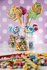 Candies including lollipops, gum balls