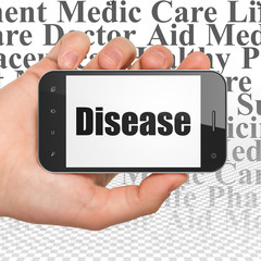 Healthcare concept: Hand Holding Smartphone with Disease on display