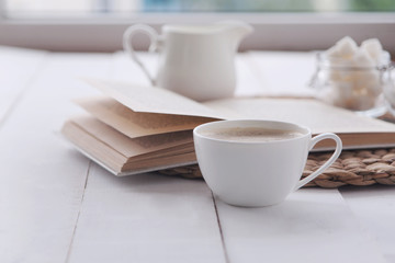 Morning coffee and reading a book