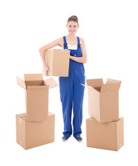 moving day concept - young attractive woman in workwear with cardboard boxes isolated on white