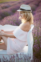 Happy woman relaxing on a park bench