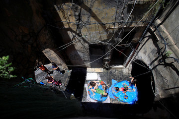 Children play in a swimming pool in Sidon's Old City