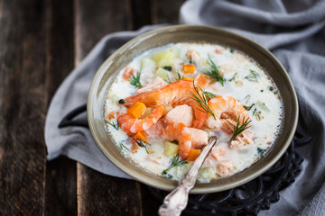 Hot salmon and shrimps cream soup