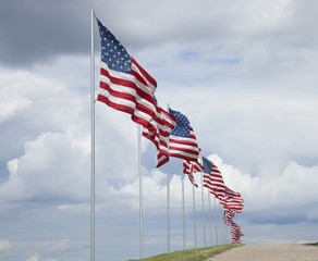 American flags of a memorial for veterans flying in the breeze