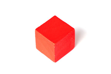 Red wood cubic shape on white background