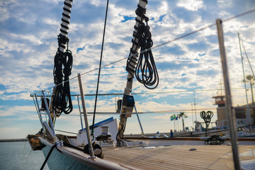 Travel vacation background. Sailing yacht mast, ropes, ocean sunny outdoors