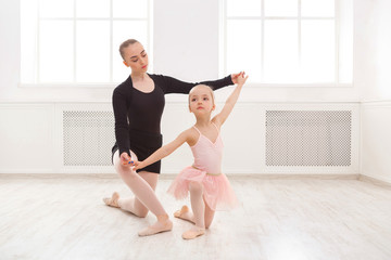 Little girl learn ballet with teacher copy space