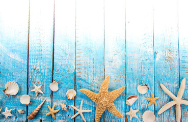 Summer traveling time. Sea holiday background with various shells.
