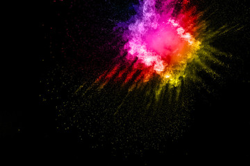 abstract color powder splatted on black background,Freeze motion of color powder exploding.
