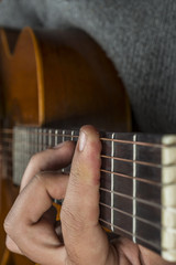 Left hand on the guitar