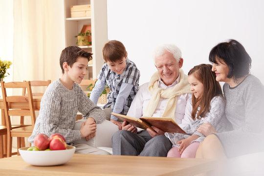 Family looking at photographs