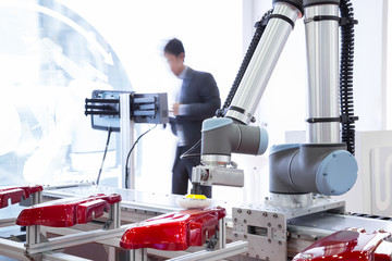 Automated robotic arm polishing automotive part in production line