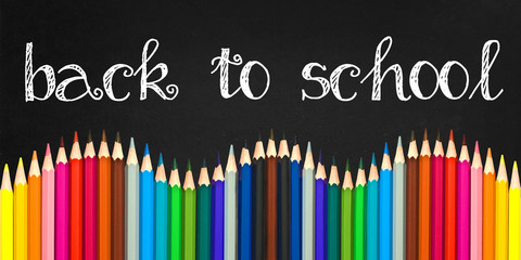 Back to school written on a black board background with a wave of colorful wooden pencils