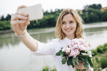 Beautiful woman taking a selfie outdors