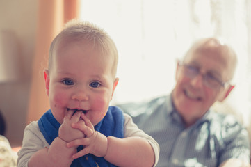 Laughing baby with grandfather