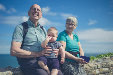 Grandparents with grandchild by the sea