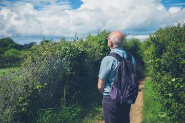 Senior man standing in nature