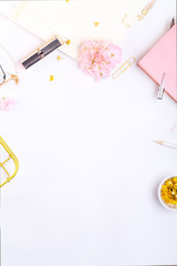 Workplace mockup with pink leather notebook and golden accessories on white background top view. Flat lay with copy space.  Feminine working style concept.