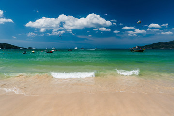 Wall Mural - Beautiful bright sea and water splash at the tropical beach, Located Patong Beach Phuket Province, Thailand