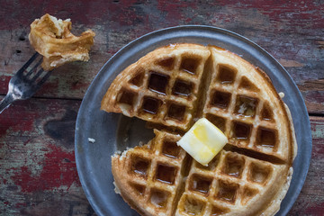 top view waffles with bite taken out on fork