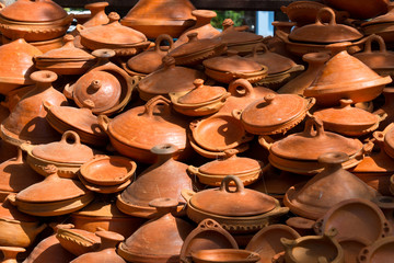 selection of tagine pottery on market in morocco