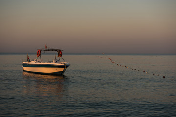 The boat at dawn on the Mediterranean sea.