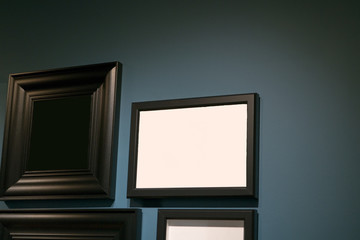 Picture frame isolate on the underexpose blue wall