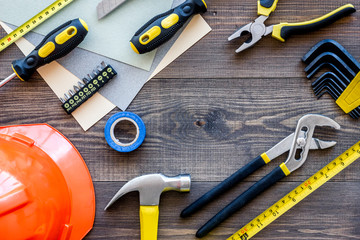 Reparing home concept. Tools on wooden desk background top view copyspace