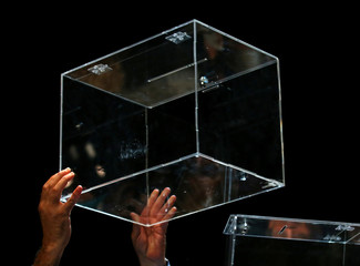 A man raises a ballot box after a meeting about the terms and conditions of the independence referendum in Barcelona