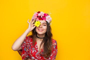 Joyful woman posing with flowers