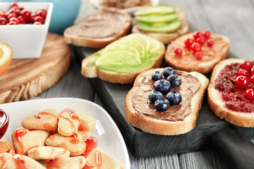 Delicious breakfast served on wooden table